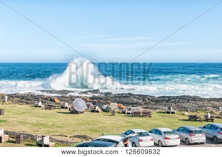 STORMS RIVER MOUTH SOUTH AFRICA - FEBRUARY 28 2016: A huge wave breaking at the day visitor picnic site at Storms River Mouth
