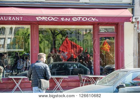 STRASBOURG FRANCE - APR 20 2016: Reflection in restaurant of protesters as hundreds of people demonstrate as part of nationwide day of protest against proposed labor reforms by Socialist Government