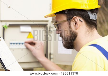 electrician checking fuse box. focus on face