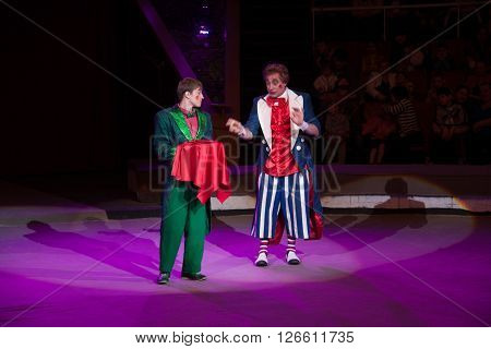 LUGANSK , UKRAINE - APRIL 9, 2016: two clowns in the circus working with viewers.