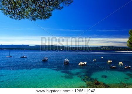 Beautiful seascape on Adriatic bay with yachts and boats and Zlatni rat beach