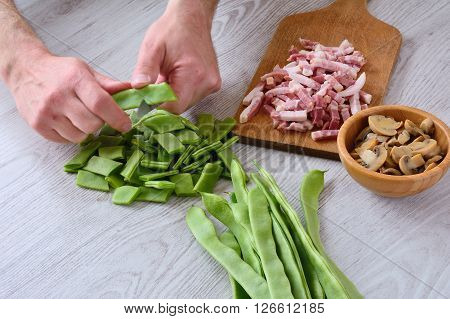 Unrecognizable Man Cutting Green Peas