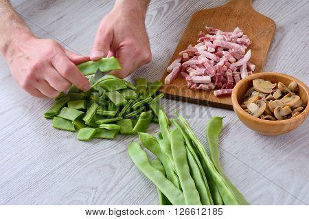 Unrecognizable Man Cutting Green Peas