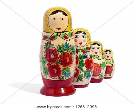 Four Matryoshka Dolls In Front Of Each Other