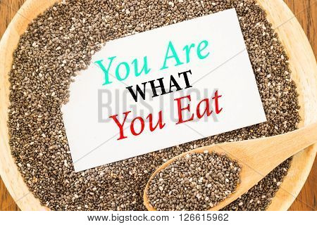 You are what you eat quote on chia seeds and business card stock photo