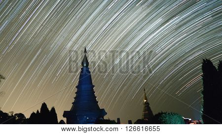 View Of Buddhist Pagoda And Startrail In Galaxy