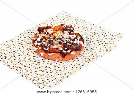 Homemade Cakes: Cake on Plate with Nuts, Chocolate and Raisins. Studio Photo