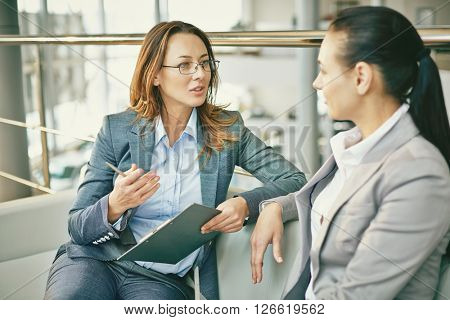 Hr manager asking questions to female candidate