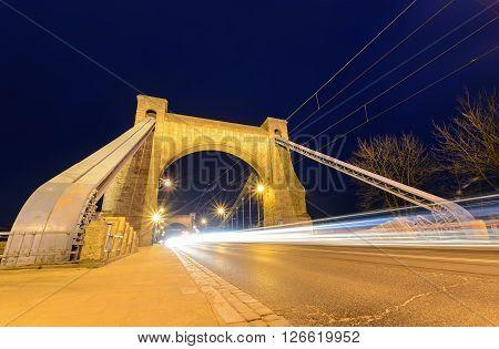 Wroclaw most famous bridge at dusk - with white auto trails. Grunwaldzki Bridge. Poland.