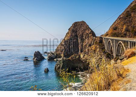 California highway number 1. Great arch bridge - viaduct runs along the Pacific coast. USA