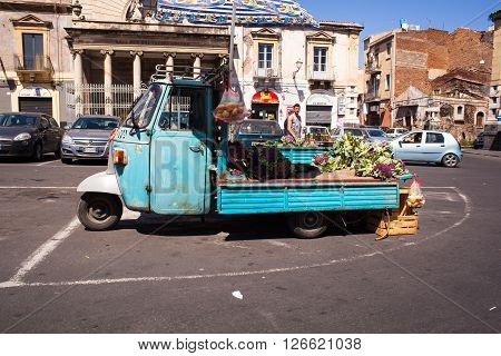 CATANIA ITALY - MARCH 31: View of old light commercial vehicle called Piaggio Ape car used for the sale of vegetables on March 31 2016