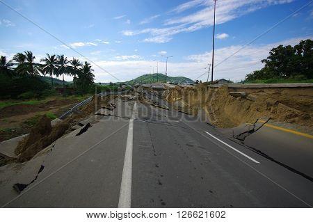Portoviejo, Ecuador - April, 18, 2016: Asphalt cracked in road after devastating 7.8 earthquake.