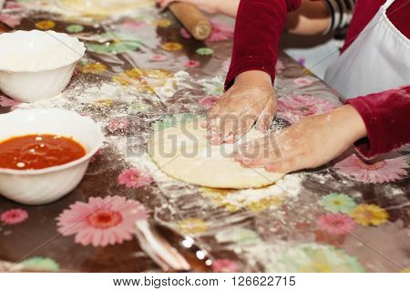 Young Children Learn To Cook A Pizza.
