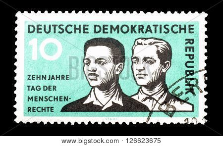 GERMAN DEMOCRATIC REPUBLIC - CIRCA 1958 : Cancelled postage stamp printed by German Democratic Republic, that shows Men of different races.