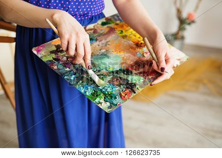 Palette With Paintbrush And Palette-knife In Artist's Hands.