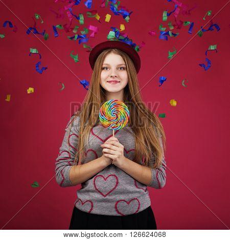 Beautiful Girl Wearing Hat Holding Big Striped Lollipop