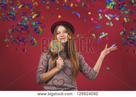 Portrait Of A Teen Girl Throws Up A Multi-colored Tinsel And Confetti