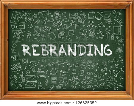 Rebranding - Hand Drawn on Green Chalkboard with Doodle Icons Around. Modern Illustration with Doodle Design Style.