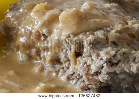 Meatloaf with Onion Sauce close up image