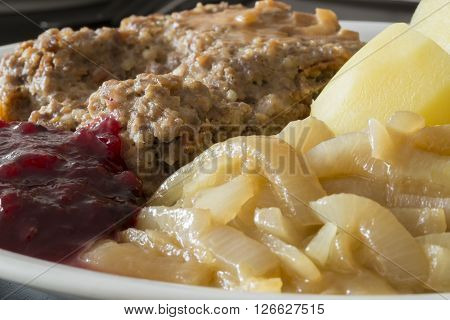Meatloaf with Potatoes Caramelised Onions and lingonberry jam.