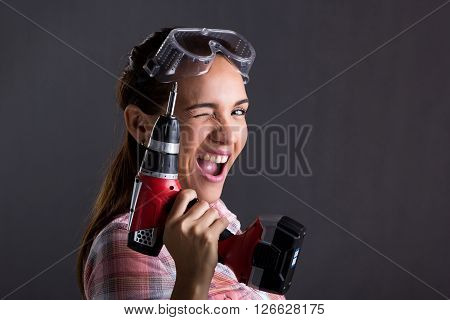 Beautiful Woman Holding A Power Drill