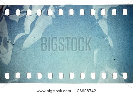 Blank crumpled noisy blue filmstrip isolated on white background