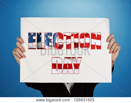 Woman holding paper with Election Day text on blue background