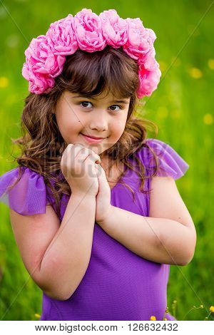 Cute little girl shone with happiness curly hair charming smile sunny summer portrait