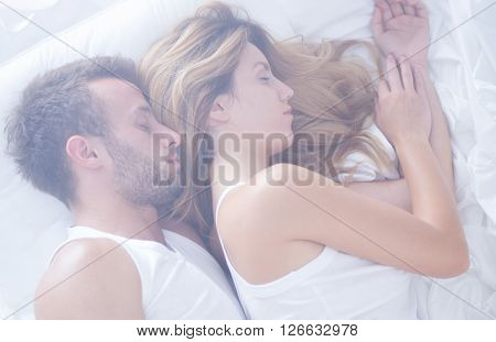 Couple Sleeping Calm In Bed