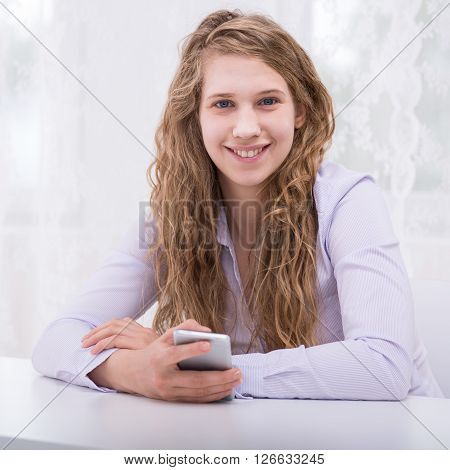 Responsible Teenager With New Cellphone