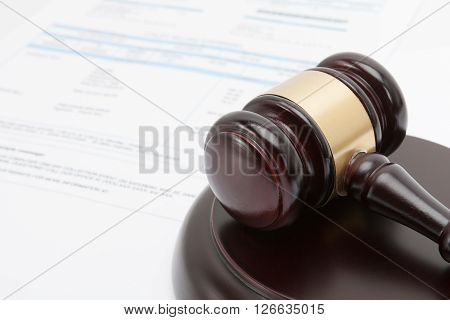 Wooden gavel over some financial documents - studio shot