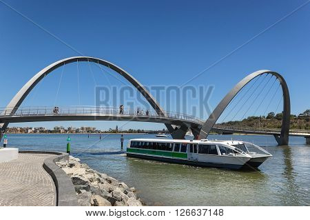 foot bridge across elizabeth quay on the waterfront of perth with a ferry passing under the bridge