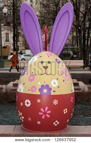 MOSCOW RUSSIAN FEDERATION - APRIL 21: Five foot egg with a pattern and hare ears as a decoration for the city to the spring holidays. April 21 2016 Tverskaya street Moscow Russia .