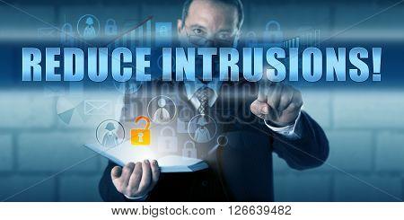 Cyber security expert is touching REDUCE INTRUSIONS! on a transparent interactive screen. Business challenge metaphor and information security concept for the prevention of possible cyber attacks.