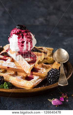 Homemade baked traditional Belgium waffles with ice cream selective focus and blank space