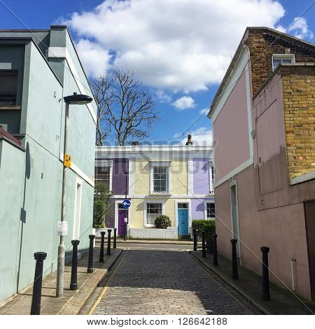 LONDON - APRIL 19: Vibrant terraced houses in a Mews on April 19, 2016 in Kentish Town, London, UK.