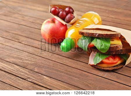 Kid school lunch on wooden background