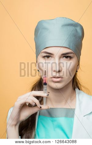 Medical Doctor With A Syringe In Her Hand