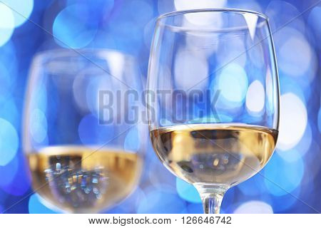 Wineglasses on blue blurred background