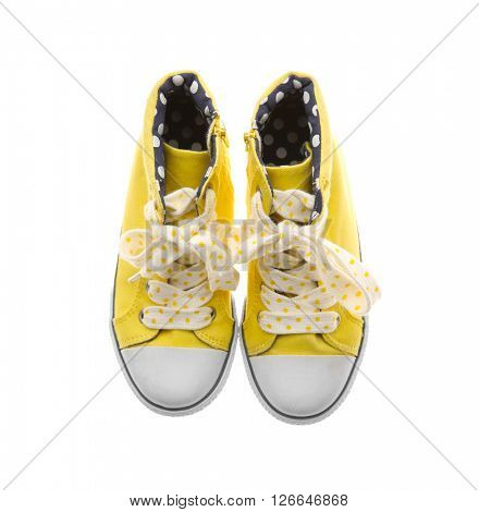 Yellow gumshoes for girls, isolated on white