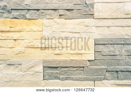 Stonewall background pattern for interior fashion design - Stone wall backdrop texture for modern buildings furniture - Construction material abstract concept - Soft pastel color tones