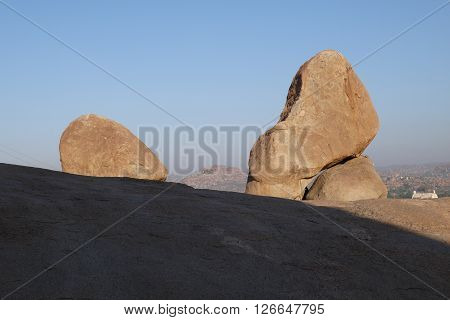 the huge boulders lying on slopes of hills in the village of Hampi in India