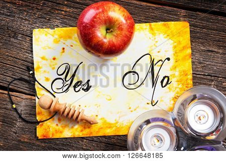 Pendulum, tool for dowsing, on yes and no choosing diagram with apple