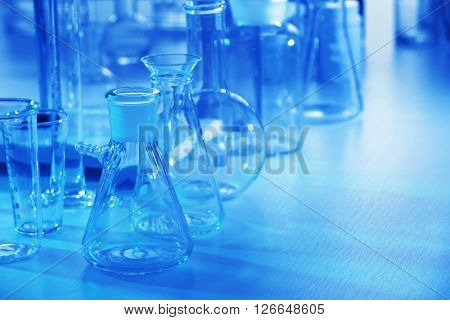 Laboratory glassware on table closeup