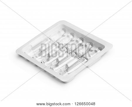 ampoules in a package on white background