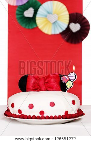 Mastic Cake decorated with ears of Minnie Mouse and a bow