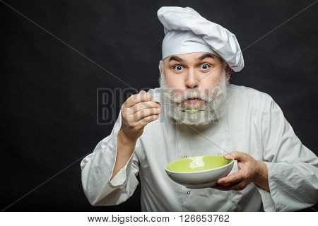 Man Cook Tastes Food
