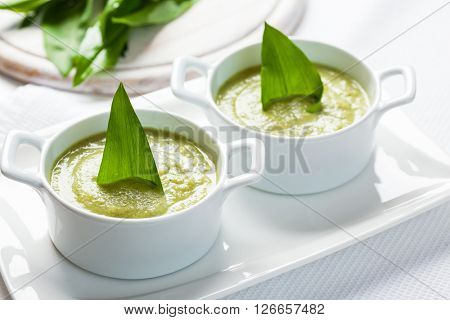 Fresh wild garlic leaves with soup