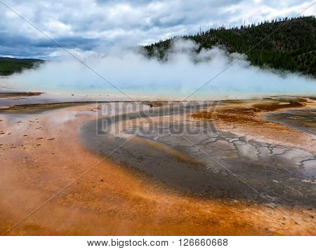 Giant geyser with hot steam rising up from the ground