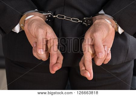 Businessman With Handcuffs